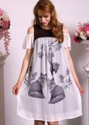 Подол летнего платья украшает красивый дизайнерский рисунок.